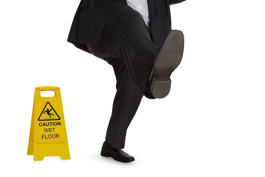 bigstock Man In Suit Slipping On Wet Fl 78015383 1 - Arlington Slip and Fall Attorney