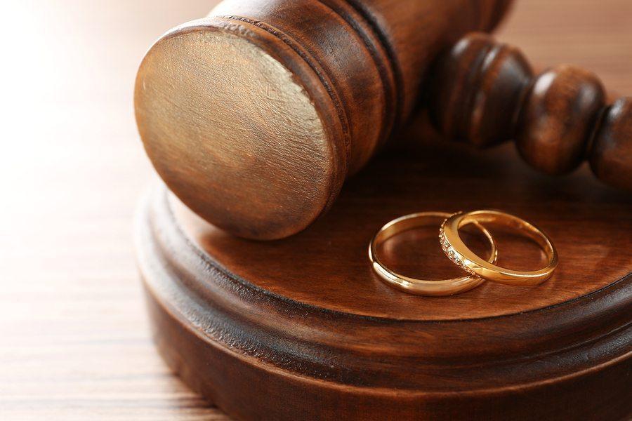 bigstock Golden wedding rings with judg 157592492 - Arlington Prenuptial Agreement Lawyer